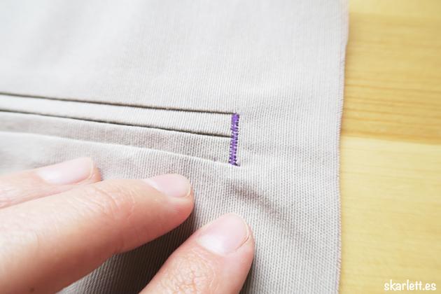 detalle de costura de refuerzo lateral en bolsillo ribeteado